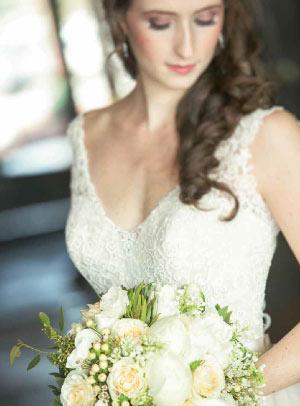 Bride's dress. Bride with flowers