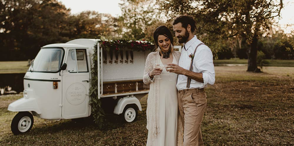 """A fixed up vintage Piaggio Ape, """"The Chuglette"""" is an adorable way to serve drinks to your wedding guests."""