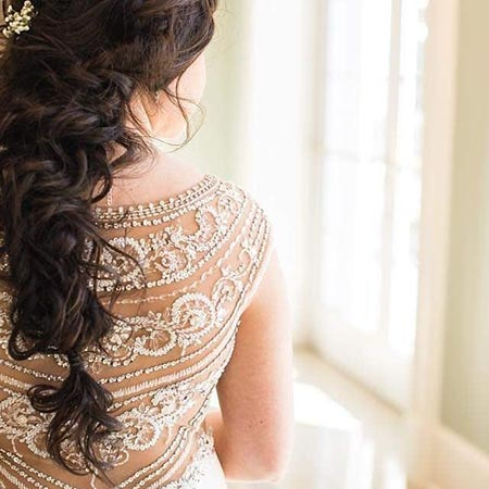 A bride looks out the window as she ponders her future